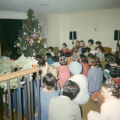 Residents gather around Christmas tree in Cobeen Hall, 1966