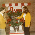 Students sell flowers to benefit the Cobeen Hall dinner dance, 1972