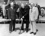 Marquette University President Rev. Edward J. O'Donnell, S.J. poses with a shovel at the Schroeder...