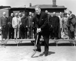 Marquette University President Rev. Edward J O'Donnell, S.J., turns the first shovel of dirt in...