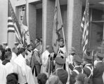 The procession pauses outside Schroeder Hall in the blessing and dedication ceremony, 1957