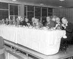 Members of the Board of Governors sit at the head table at a dinner held in conjunction with the...