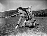 Mike Czernicki crouches in a three point stance, 1937