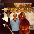 Robert Gassert, S.J. celebrates Thanksgiving with individuals in costume