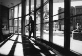 A student walks in the front doors of the Brooks Memorial Union