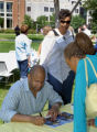 Rondell Sheridan signs autographs at an Ethnic Alumni Association reunion event, 2005