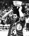 Marquette basketball player Dean Meminger holds the N.I.T. championship trophy, 1970