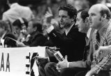 Marquette basketball coaches sit on the bench during a NCAA tournament game, 1977