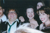 Chris Farley poses with a group of women