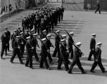 Midshipmen march on the tennis courts