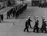 Midshipmen drill at the tennis courts