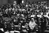 A group of nuns listen to a lecture
