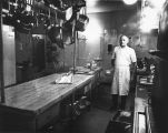 Chef stands in the Jesuit Residence kitchen, 1973