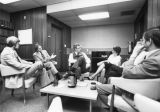 Law school faculty engage in conversation in the lounge