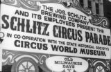 A sign advertises the Schlitz Circus Parade, 1971