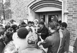 Students gather in protest outside O'Hara Hall, 1969