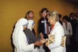 Mother Teresa greets the Whealon family, 1981