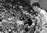 Robert Hall drives against Indiana guard Steve Alford, 1984-1985