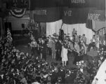 The crowd gathers around the stage during a military ball held at Marquette University
