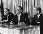 Neil Armstrong, Buzz Aldrin, and Michael Collins gather at a press conference, 1969