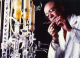 Chemistry professor Daniel Haworth works with test tubes, circa 1987