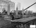 Construction workers work at the site of the new Olin Engineering Center, 1976