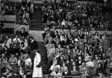 Fans enjoy a basketball game, 1977-1978