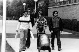 Students transport a keg across the Marquette campus, 1977-1978