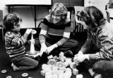 A child plays with rings and blocks at the Marquette Speech and Hearing Clinic,1984