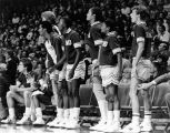 The Marquette men's basketball team watches action on the court from the sidelines, 1983-1984