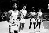 Members of the men's basketball team wear cowboy hats and holsters, 1985-1986