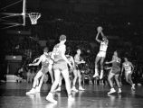 Walt Mangham takes a jump shot during a game, 1959-1960