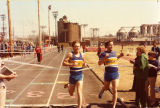 Marquette's Scott Roberts and Patrick Smith break the tape at the finish of the 1500 meter race,...