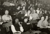 Marquette students sit in their chairs for a chorus practice, circa 1955