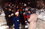 Students sing at the Miracle on Central Mall event outside Saint Joan of Arc Chapel, 1992