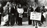 A group of Marquette students hold signs protesting the draft, 1979-1980