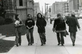 A group of women talk while walking east on Wisconsin Avenue in front of Johnston Hall, 1974