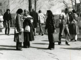 Students stop to chat while walking between classes on the campus mall, 1978