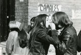 A couple shares a tamale from a street vendor, 1972