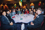 A group of people sit at a table at the Inaugural Diversity Gala hosted by the Ethnic Alumni...