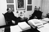 John P. Raynor S.J. talks in the president's office with Albert DiUlio, S.J., 1990