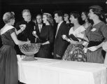 Rev. Edward J. O'Donnell, S.J., accepts a glass of punch at a student social event