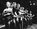 Actresses line up, chorus-line style, for a Marquette Players production of Guys and Dolls, 1969