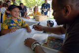 Rondell Sheridan signs autographs during Alumni Reunion Weekend at Marquette, 2007