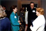 Mary Ellen Muth converses with Robert A. Wild, S.J., at a Women's Council gathering