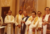A group of priests participate in commencement-related activities, 1990
