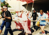 Runners dressed as priests and the Pope participate in Al's Run, 1986