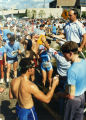A fireman sprays runners with water after Al's Run, 1986