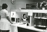 A nursing student works on tasks at the hospital desk