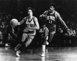 Gary Rosenberger dribbles the ball around an opposing player from DePaul, 1977-1978
